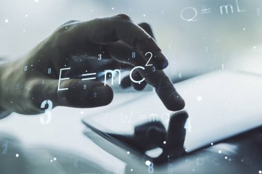 Creative scientific formula concept with finger clicks on a digital tablet on background. Multiexposure