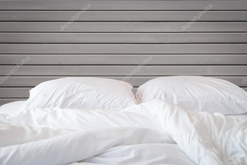 Close Up White Bedding Sheets And Pillow On Wooden Wall Room Background, Messy  Bed Concept U2014 Photo By PhanuwatNandee