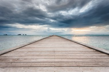 Wood bridge to the sea at sunset beach in Koh Samui, Thailand