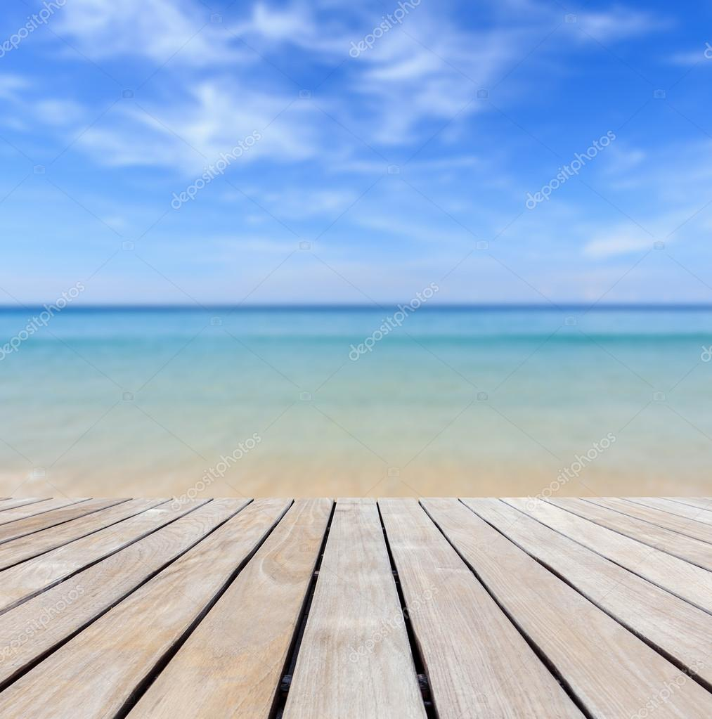 Wood Floor On Beach Sea And Blue Sky For Background Stock: Wood Decking And Tropical Beach