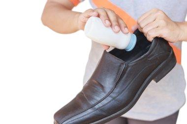 Hand put powder to shoe