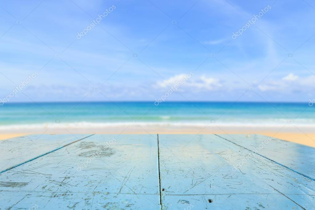 wood table and view of tropical beach