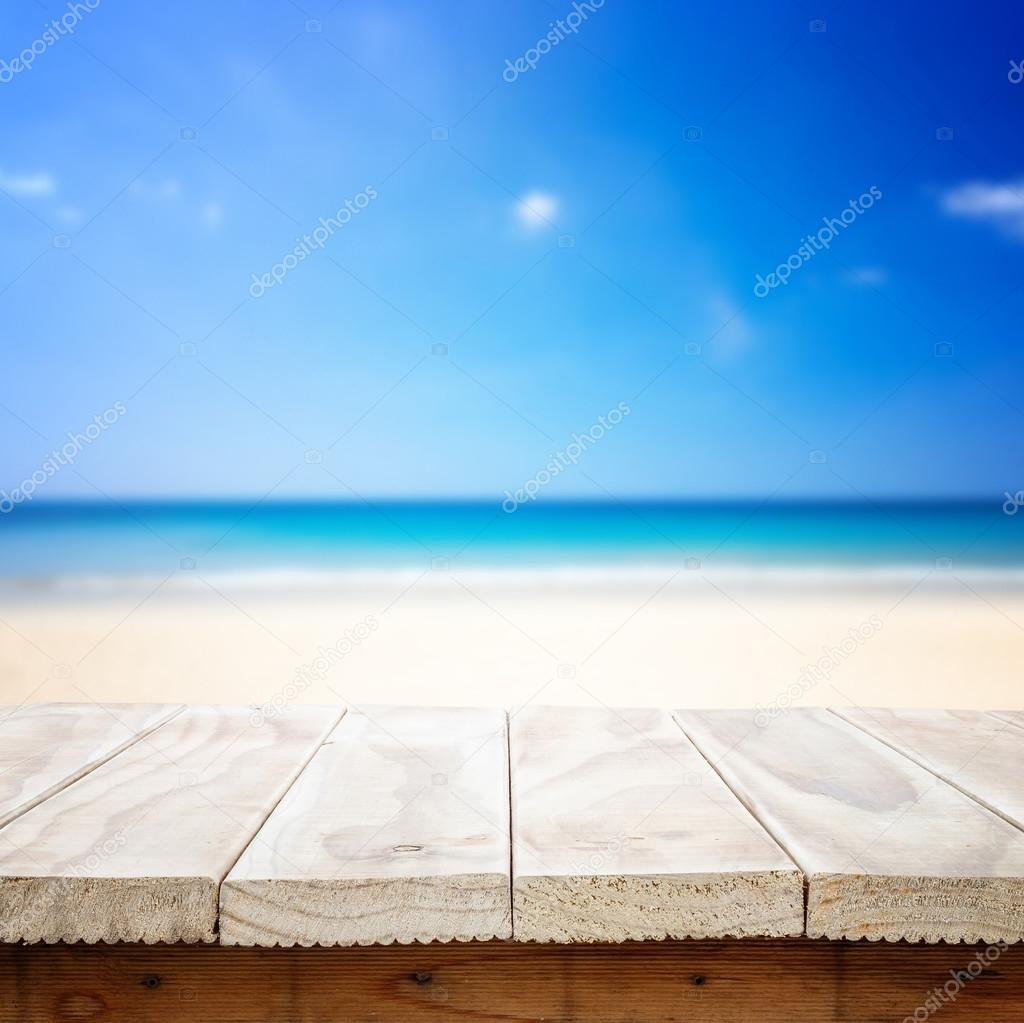 wooden table and tropical beach