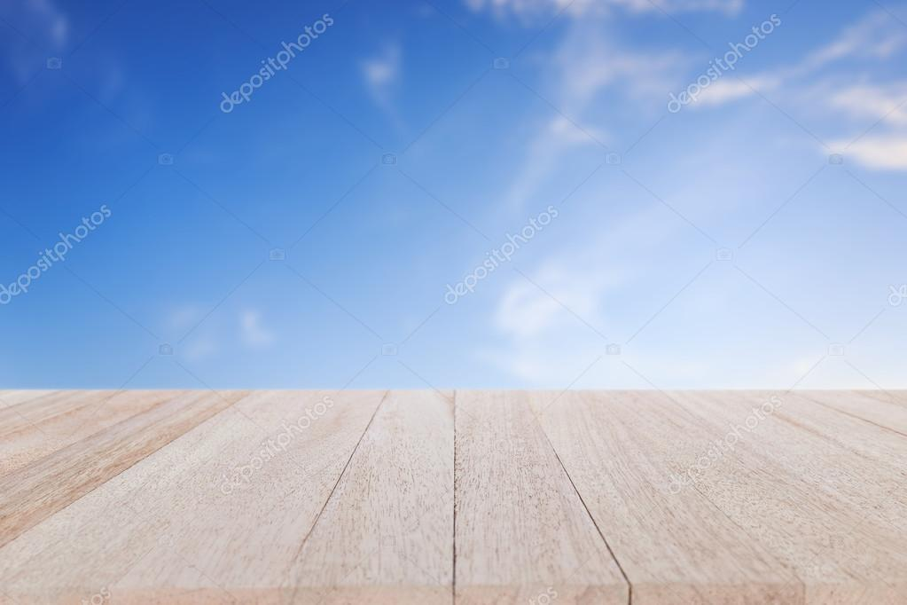 wooden table and  blue sky
