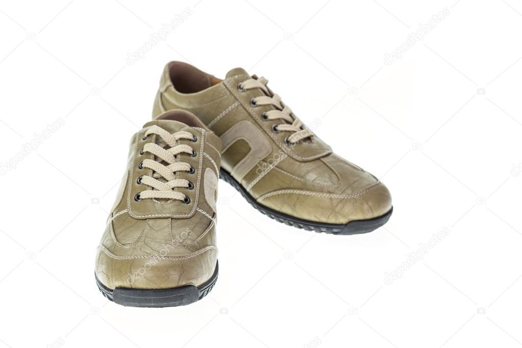Neuer braun Schuh isoliert auf weiss — Stockfoto © PhanuwatNandee ... 1d3c4c2290