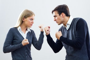 Businesswoman and businessman are very angry at each other