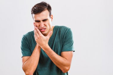 Man is having toothache.