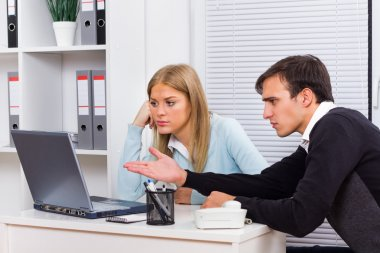 Businessman with his secretary very angry at her