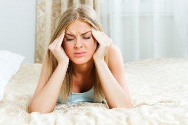 Woman is having a headache