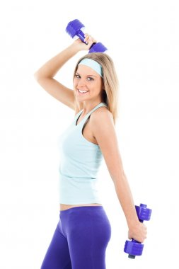 Beautiful young woman with dumbbell