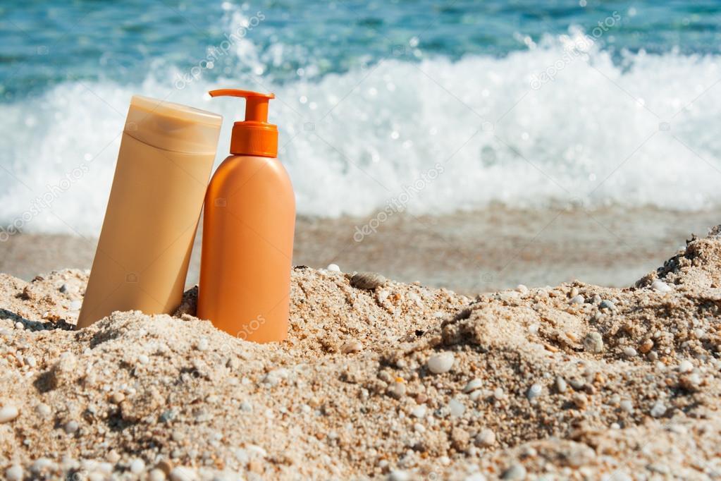 Suntan lotion bottles on the beach, Sun protection