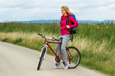 Woman with a bike on nature