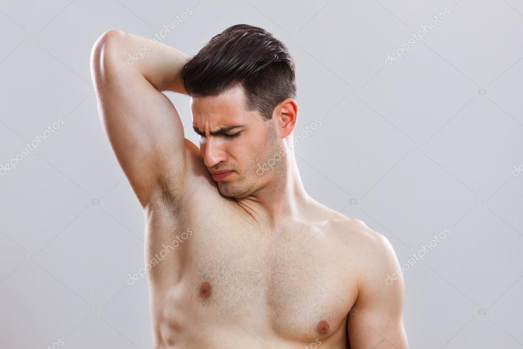 handsome man smells under armpit stock photo inesbazdar 69537971