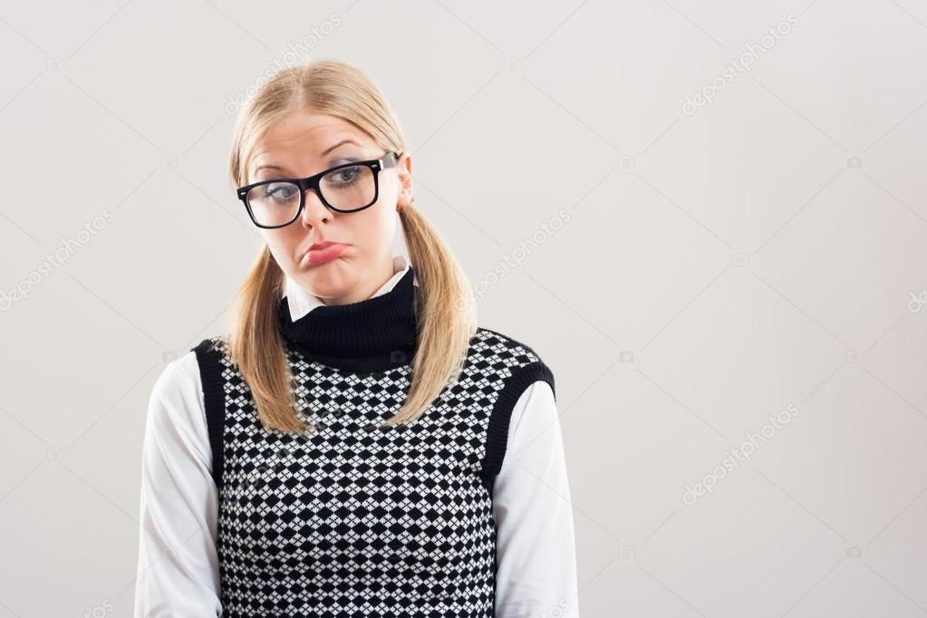 Cute nerdy woman is very sad because of something