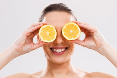 woman with slices of lemon.