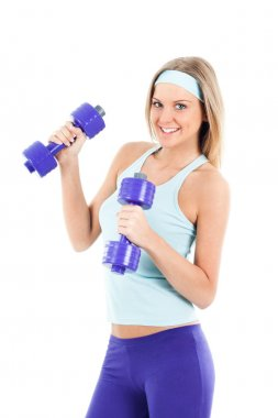 Cheerful young woman with dumbbell