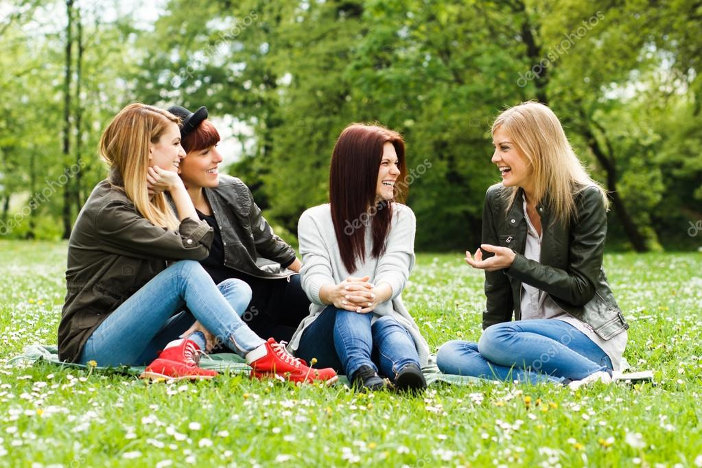 Girls sitting in the park and talking about something