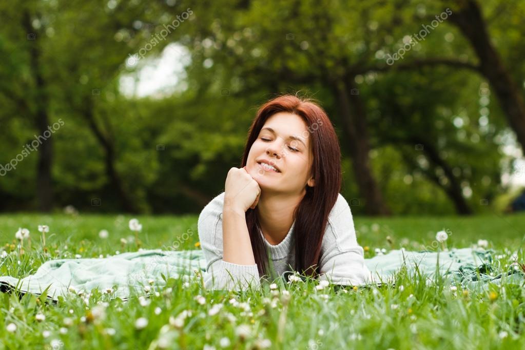 Girl enjoys lying down in nature