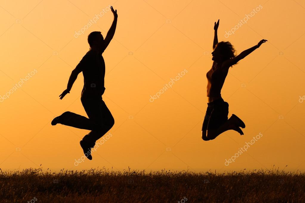 Couple jumping in nature