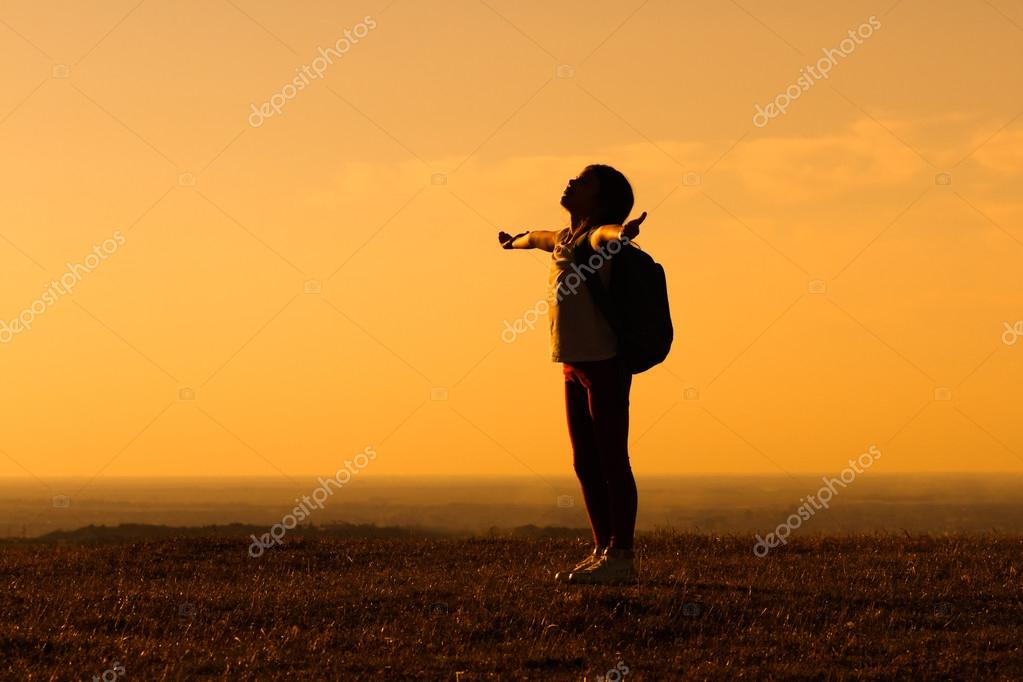 little girl travelling in nature