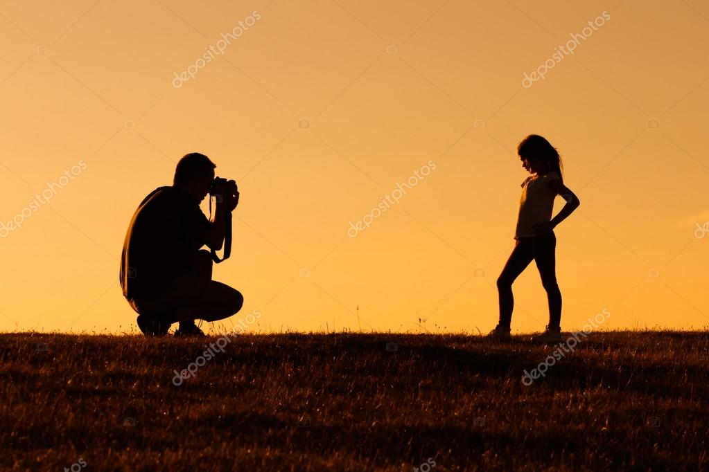 father with girl in nature