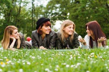 girls resting in park