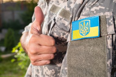 Ukrainian soldier with chevron on the uniform