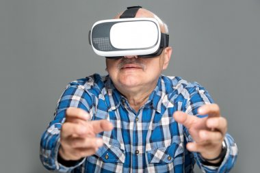 Eldely man in virtual reality glasses