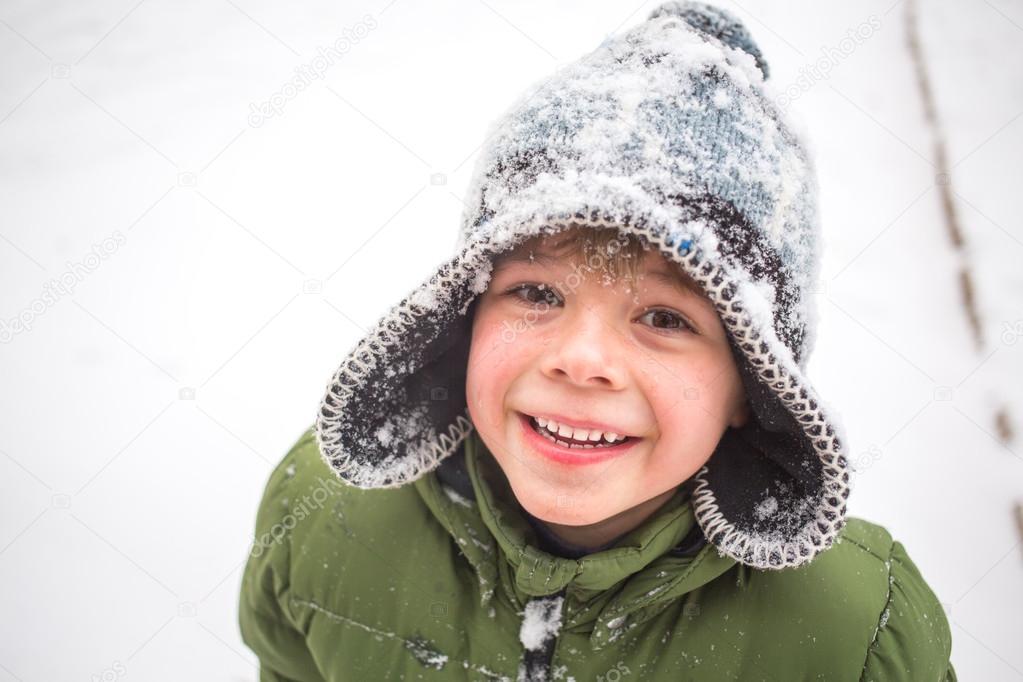 Boy winter playing