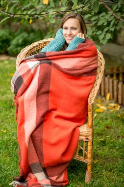 Beautiful girl resting in autumn garden