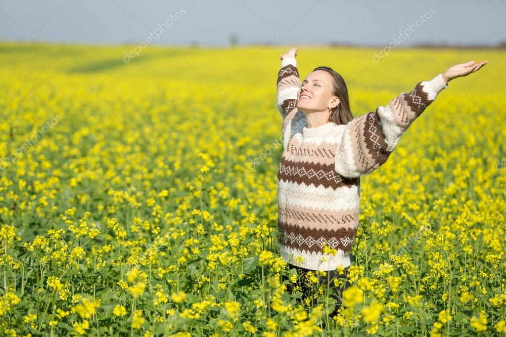 Young woman on flower field and sky enjoy life