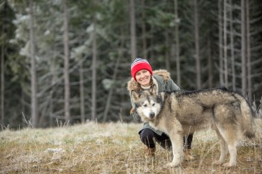 Woman with dog. Alaskan malamute