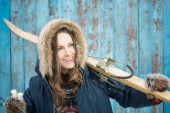 Fotografie Lyžařské žena nad vintage blue