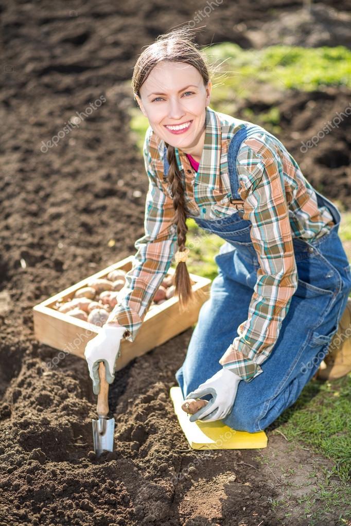Female farmer working in garden