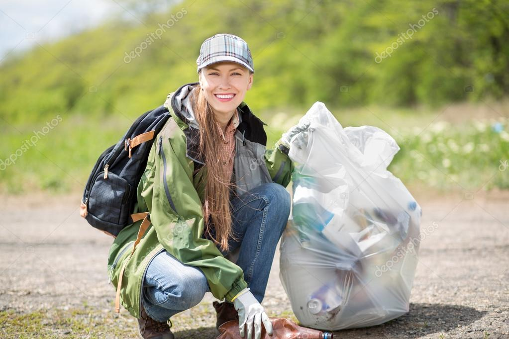 Woman picking up trash