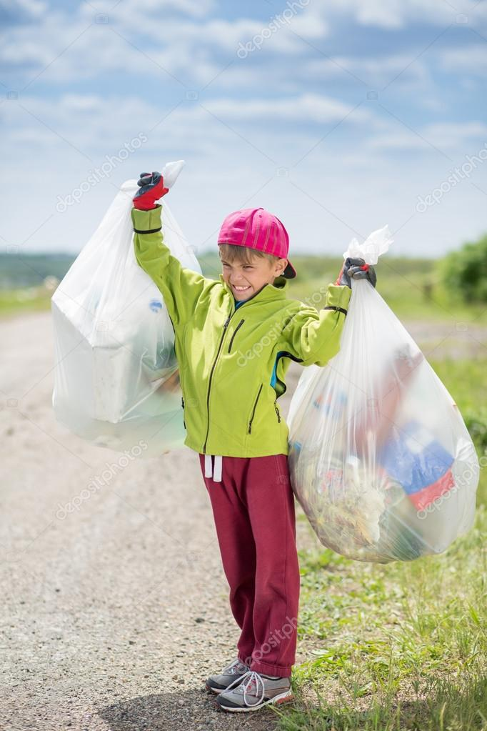 Boy picking up trash