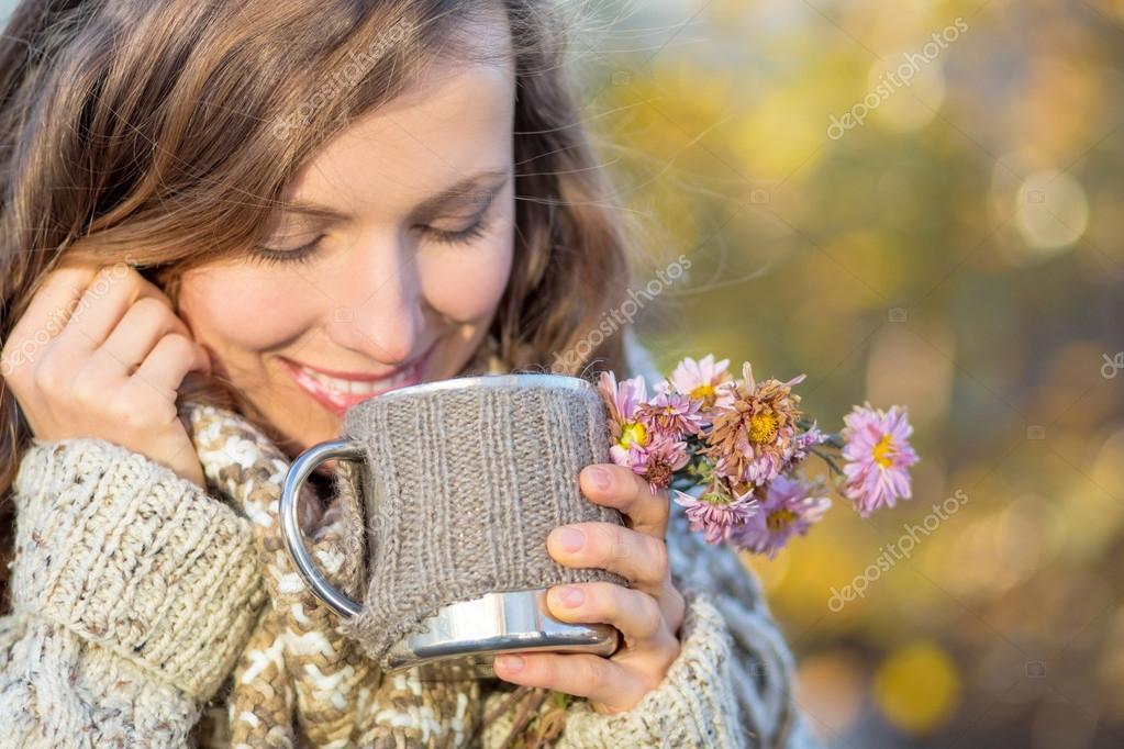 Autumn woman drinking morninig tea