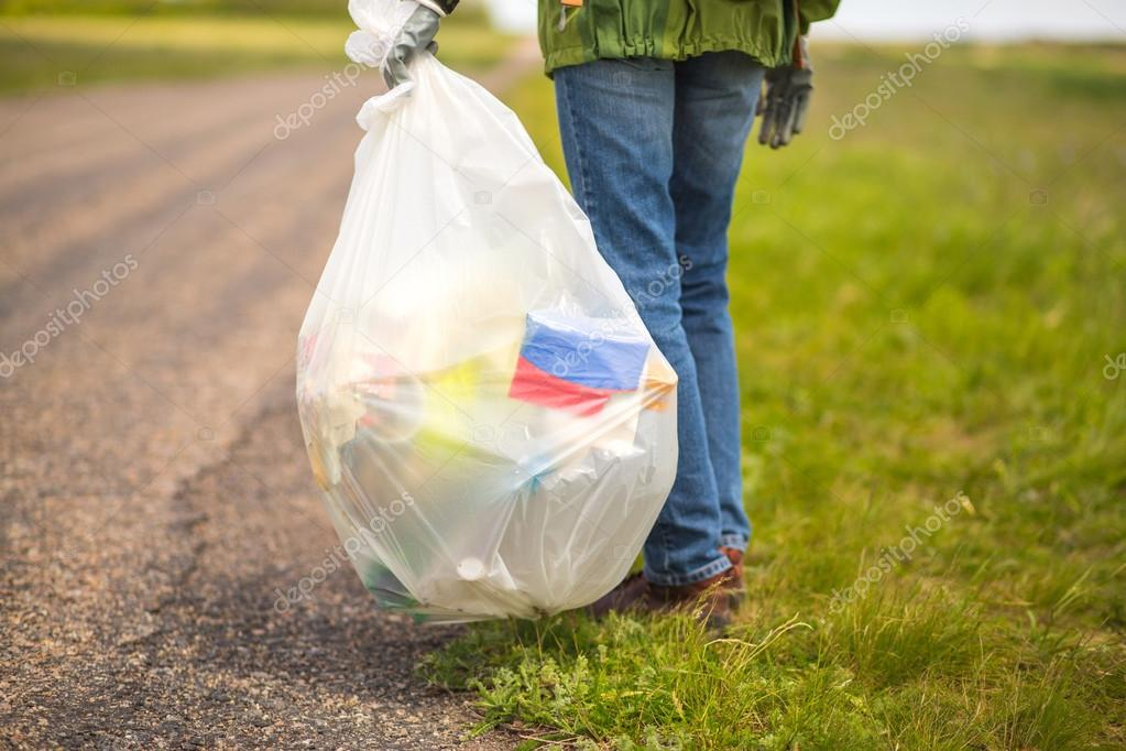 Volunteer picking up trash
