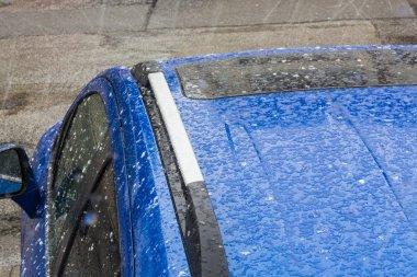 Hail on a car roof.