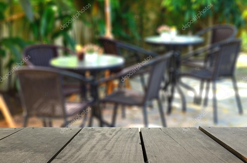 Defocused and blur image of wood terrace and coffee shop garden for background usage