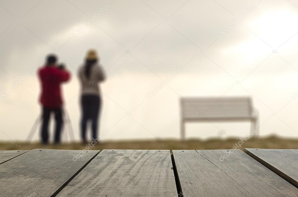 Defocused and blur image of terrace wood and sweetheart standing at amazing Thailand viewpoint for background usage