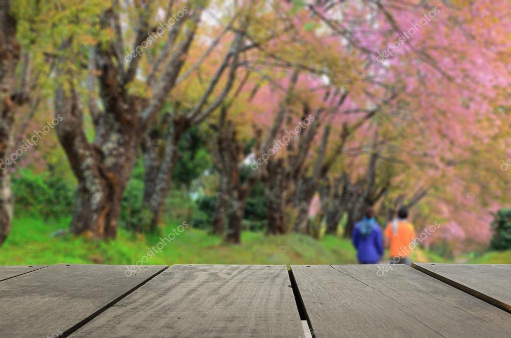 Defocused and blur image of terrace wood and beautiful garden fo