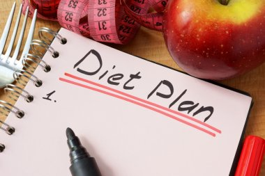Diary with a record diet plan on a table.
