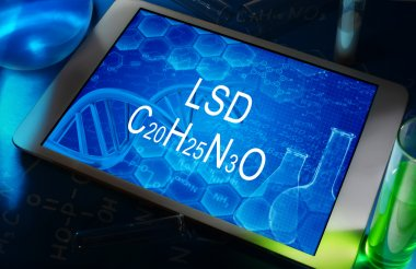 The chemical formula of LSD on a tablet with test tubes