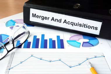 File folder with Merger and Acquisition and financial graphs.