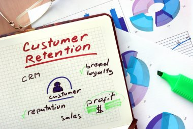 Notepad with words customer retention concept.