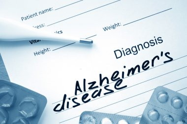 Diagnostic form with diagnosis Alzheimers disease and pills.