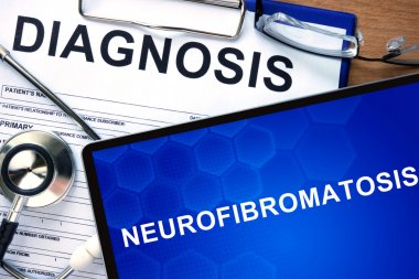 Diagnostic form with diagnosis Neurofibromatosis and pills.