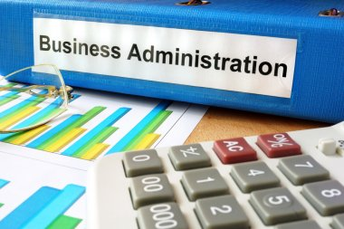 Folder with label business administration  and charts.