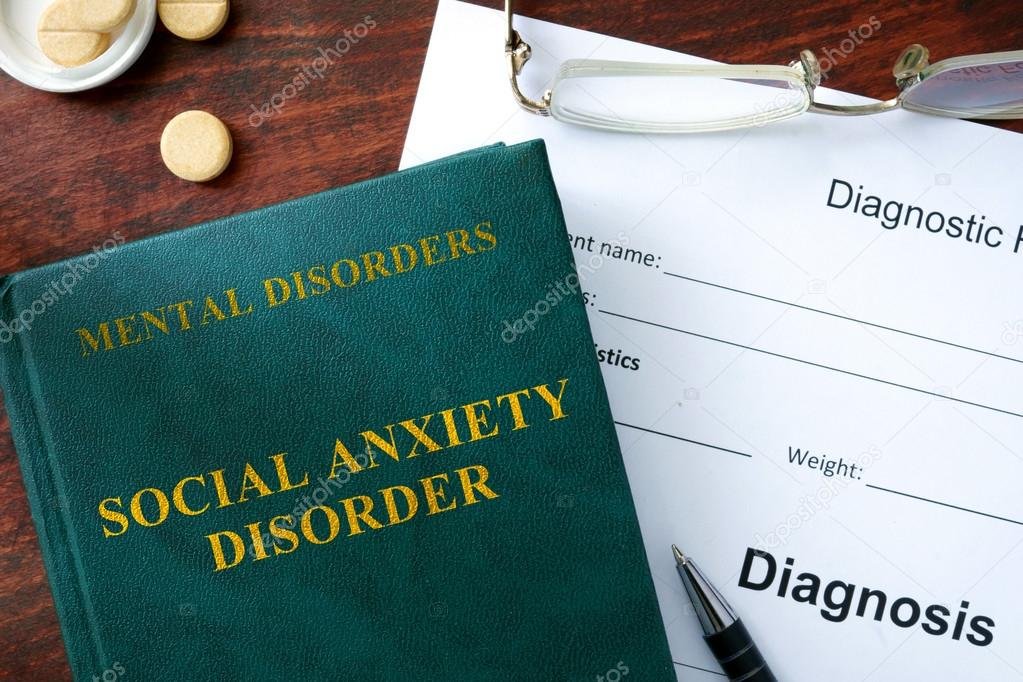 Social anxiety disorder concept  Diagnostic form and book on a table